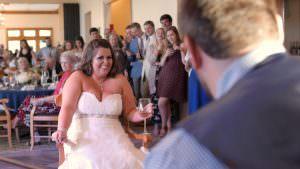 Bride listening to groom singing