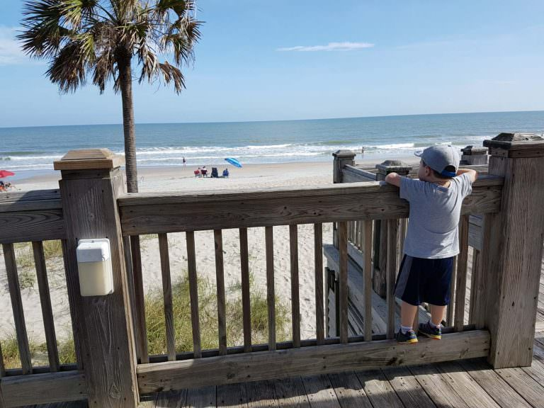 Child Looking at Beach