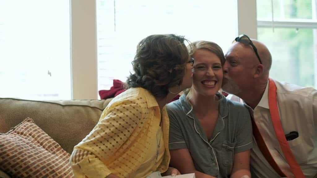 Bride and Parents Kiss